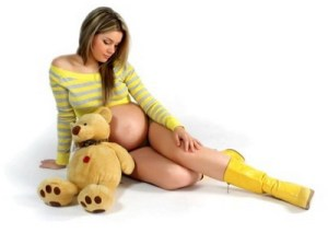 Interestingly, pregnant women are often infantilized.  For some people, carrying a baby apparently makes them feel both childish and sexy: http://www.oplife.net/how-to-go-for-sex-during-pregnancy/
