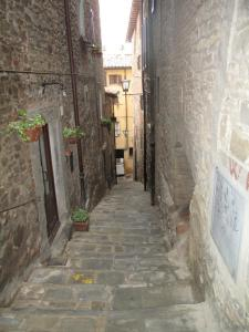 These narrow stairs are far more steep than they appear to be in this photo. Cortona, Italy.