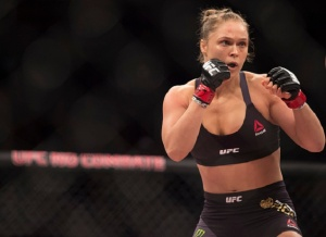 "When asked sexist questions about her reproductive capacity, Rousey said that she was an ""ovarian goldmine"" and would not waste her great genes."